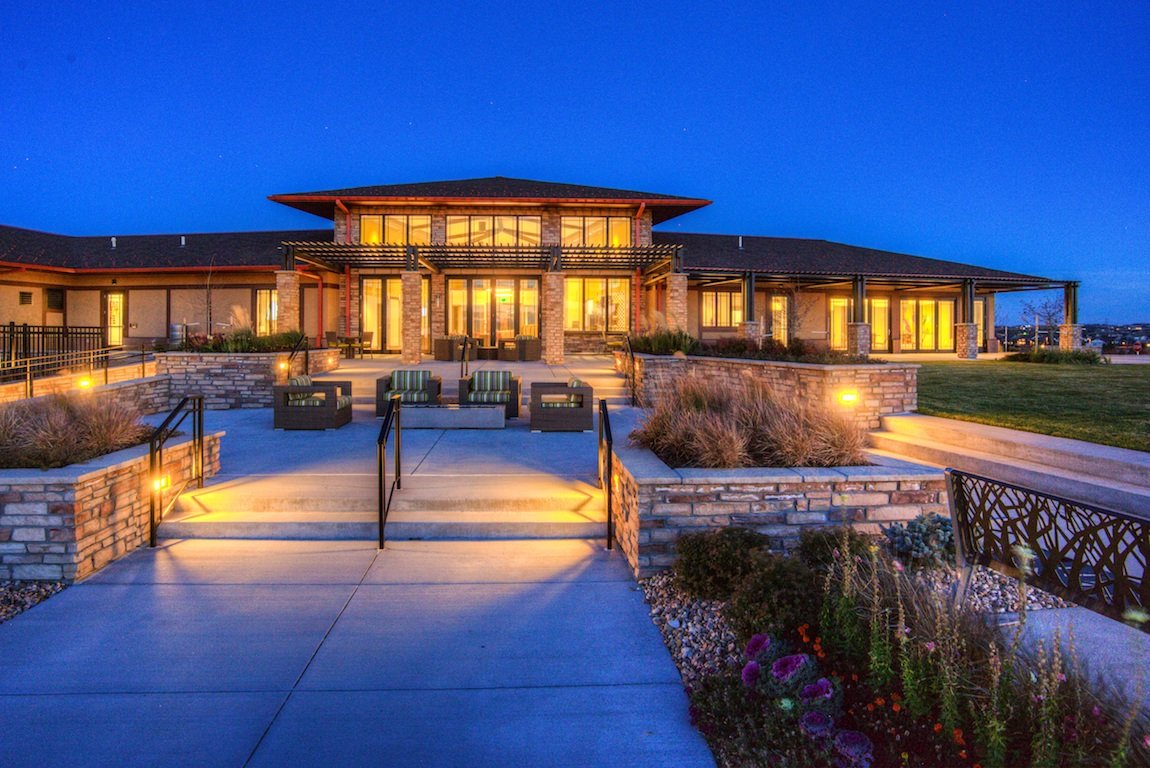 View of clubhouse during dusk at the Toll Brothers at Inspiration community.