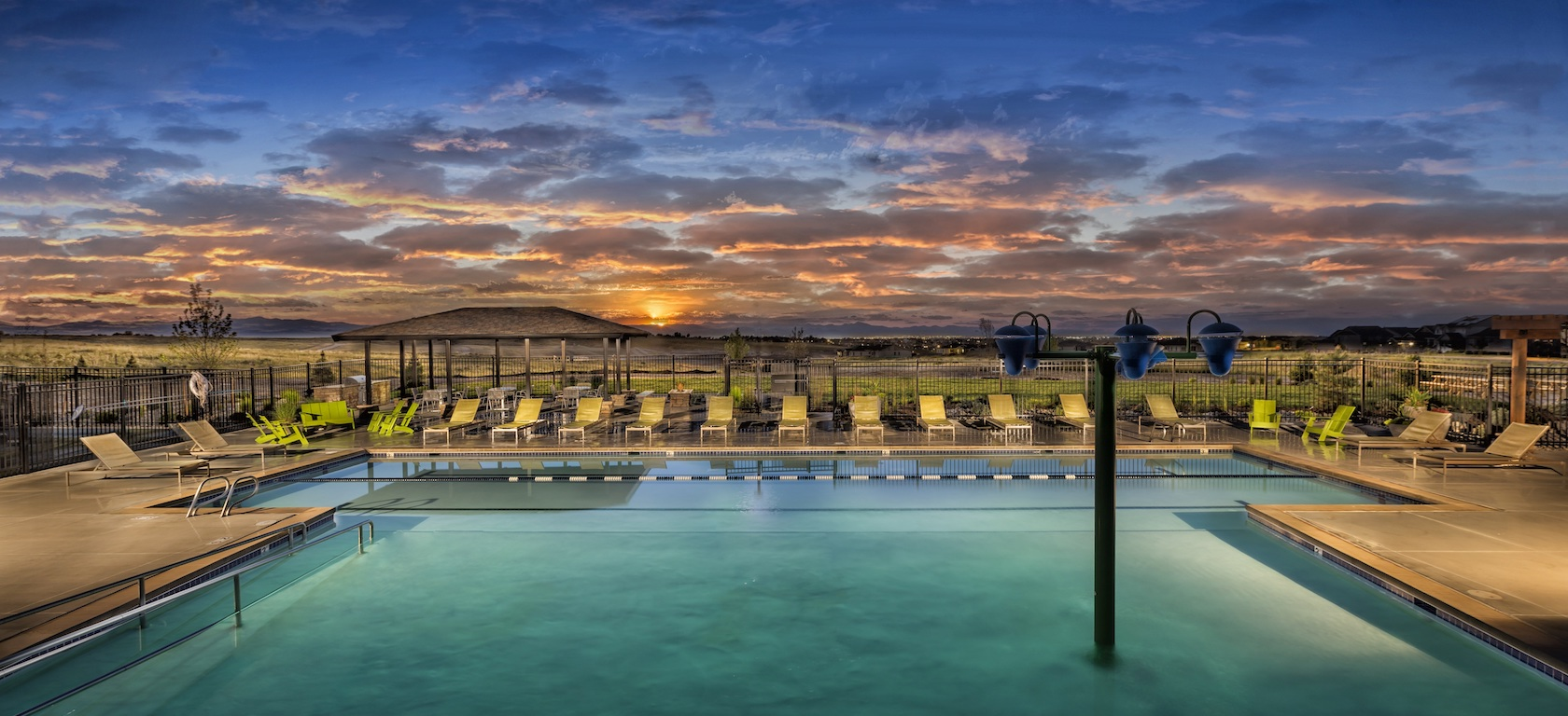 Pool overlooking a sunset the Toll Brothers at Inspiration community.