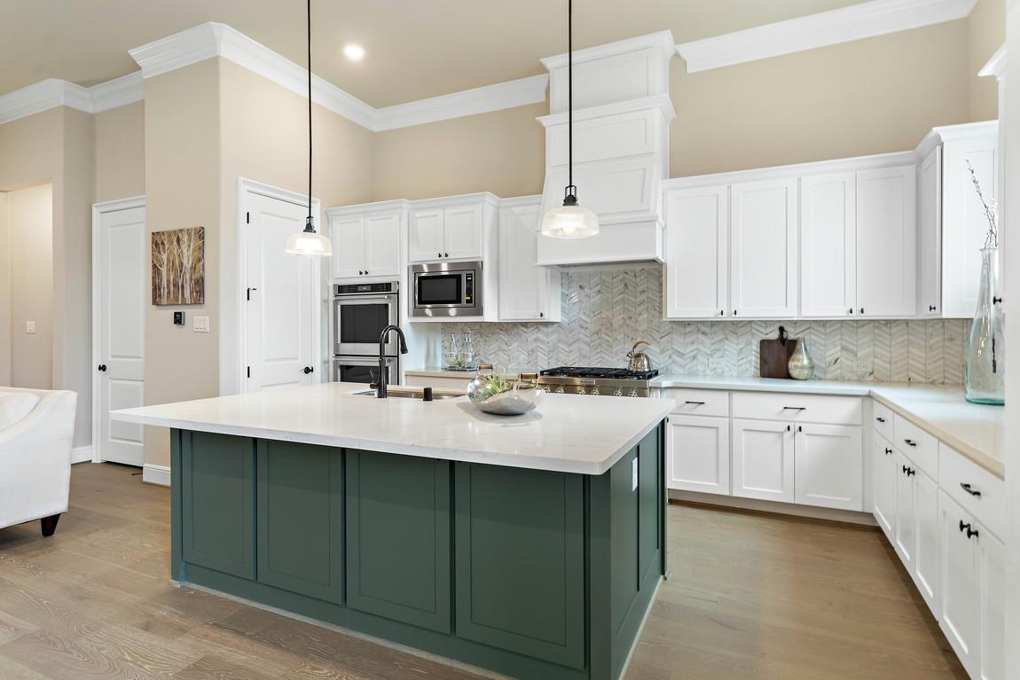 Luxe kitchen design featuring green island