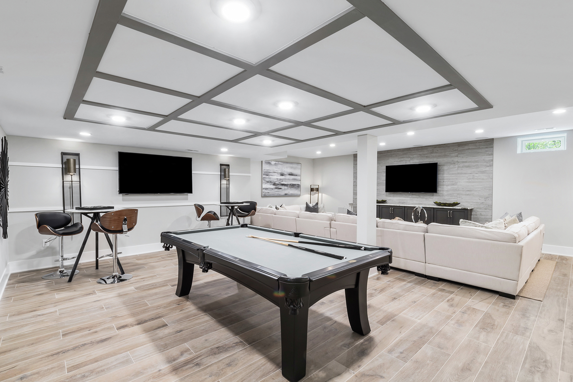 Expansive basement with entertainment area