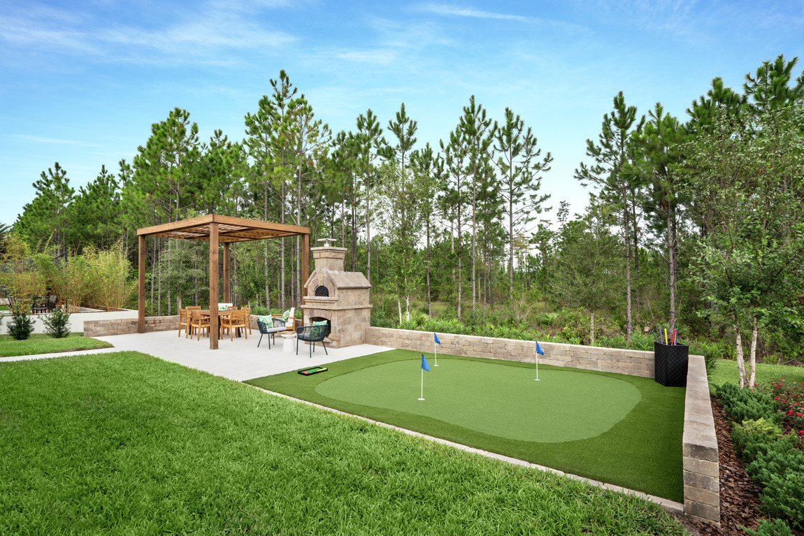 Luxe backyard highlighted by putting green
