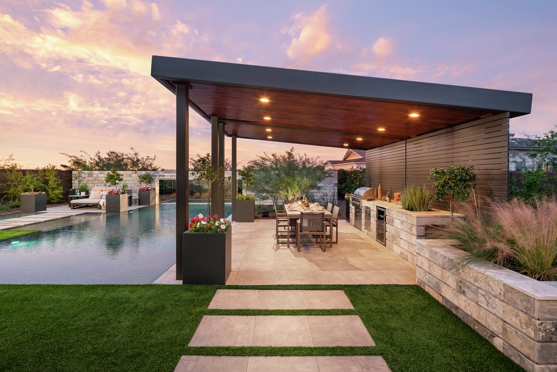 Stunning backyard kitchen and bar design by pool