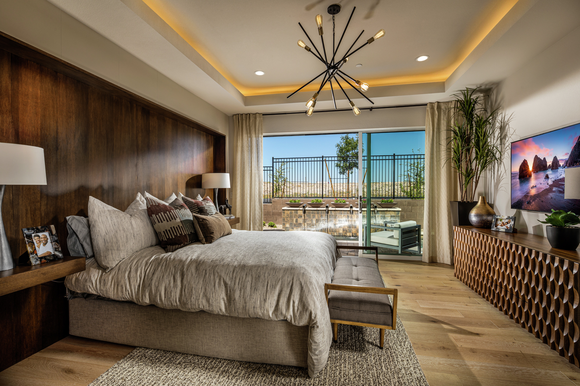 Luxe bedroom highlighted by accent lighting