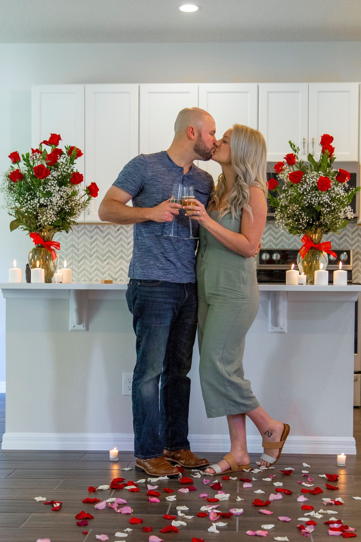 Couple celebrating their surprise engagement in their new Toll home
