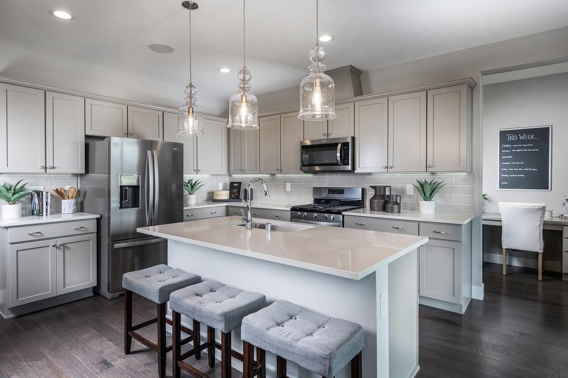 Ivory quartz island countertop in modern kitchen