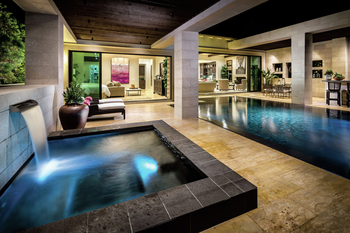 Luxe hot tub and pool in modern backyard design