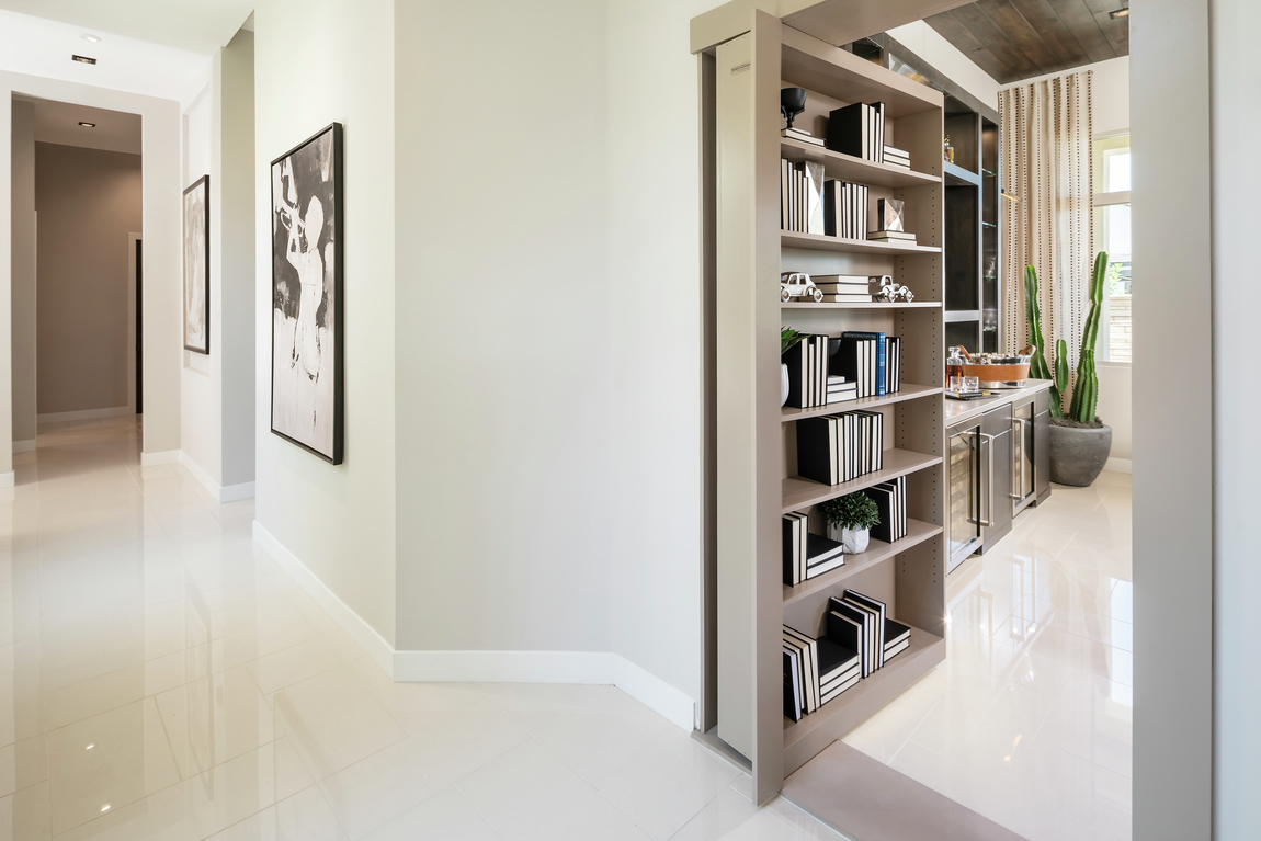 Jaw-dropping bookcase that doubles as room door