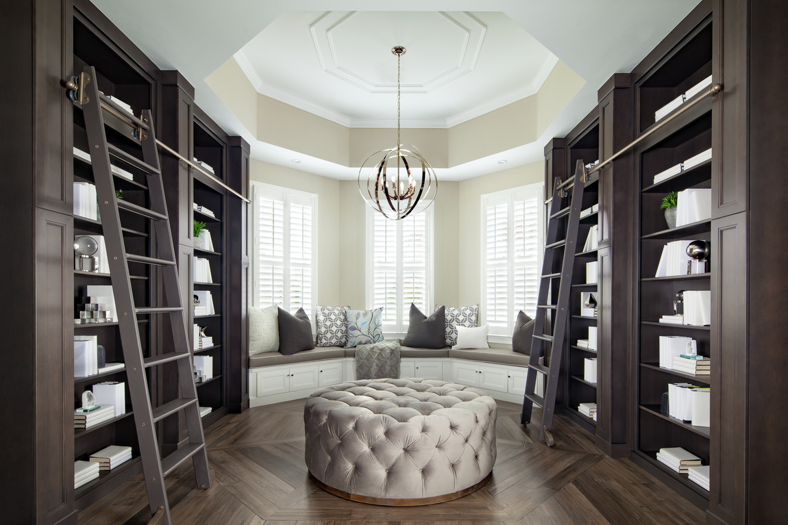 Sophisticated home library with dark cabinetry