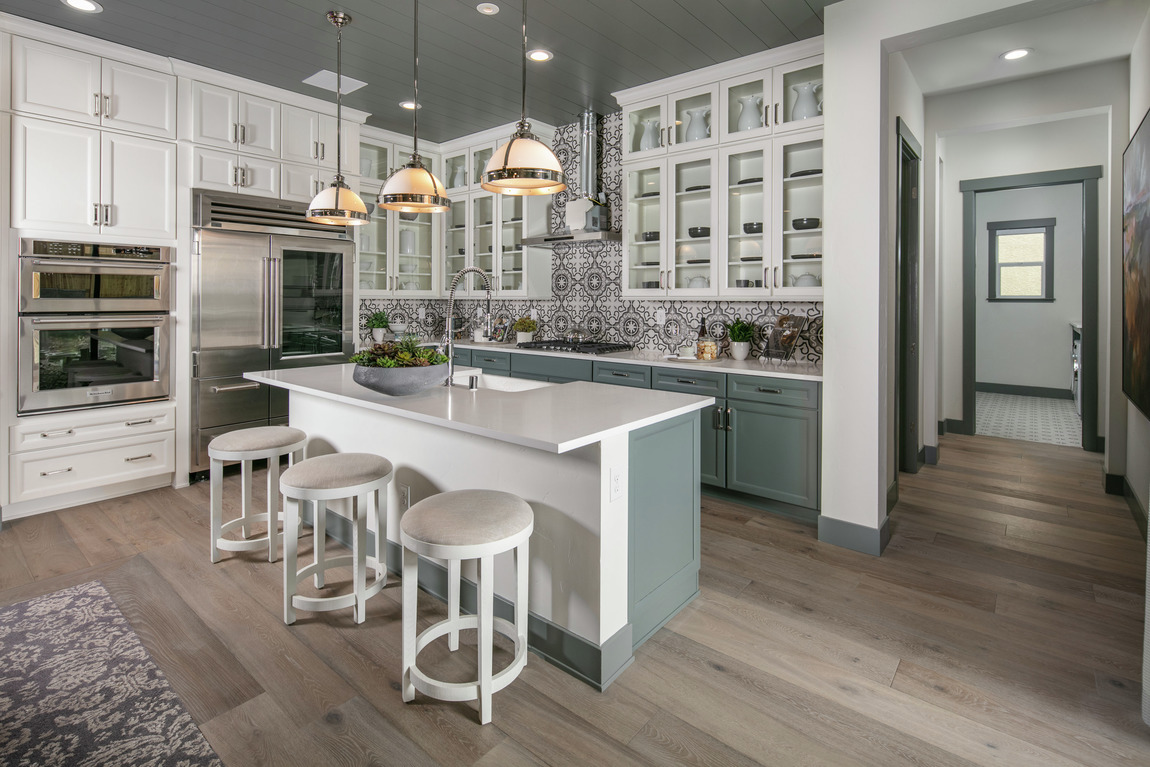 Luxe kitchen featuring intricate backsplash, a popular home design trend