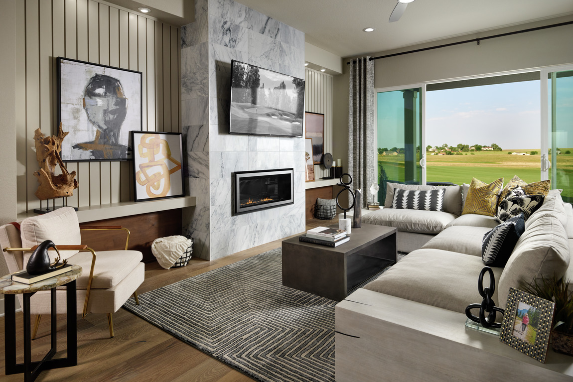 Living space that capitalizes on popular home design trends such as natural elements, accent walls, and other desirable features