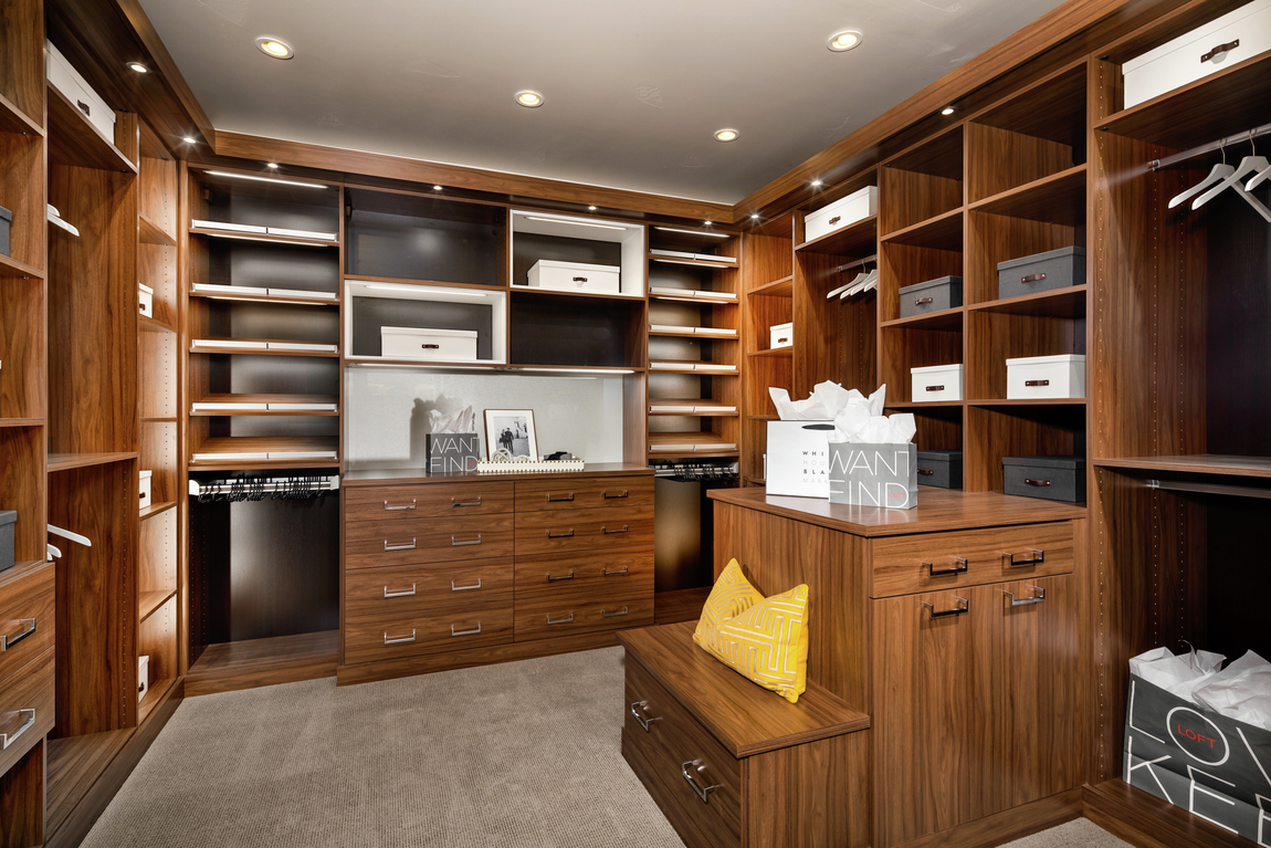 Dual closet with dark wood elements and black backing.