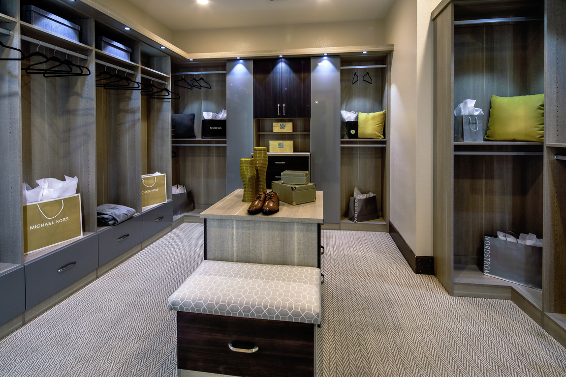 Luxury closet with spotlights, center island and built-in hanging space