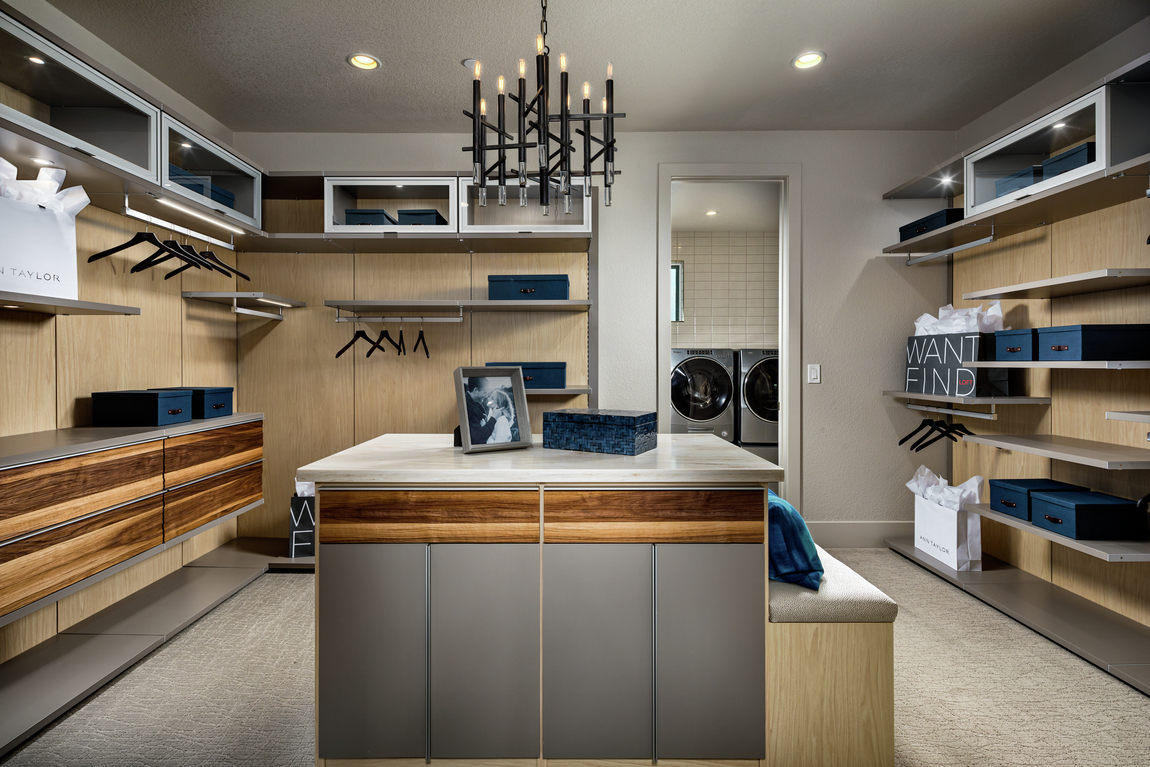 Mid-century modern transitional closet design connecting to laundry room with wood back