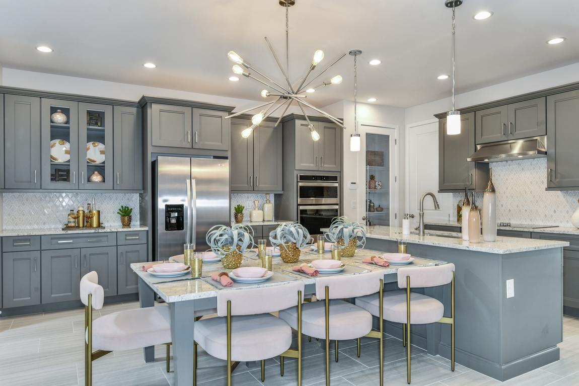 Eye-catching chandelier in pleasing kitchen design