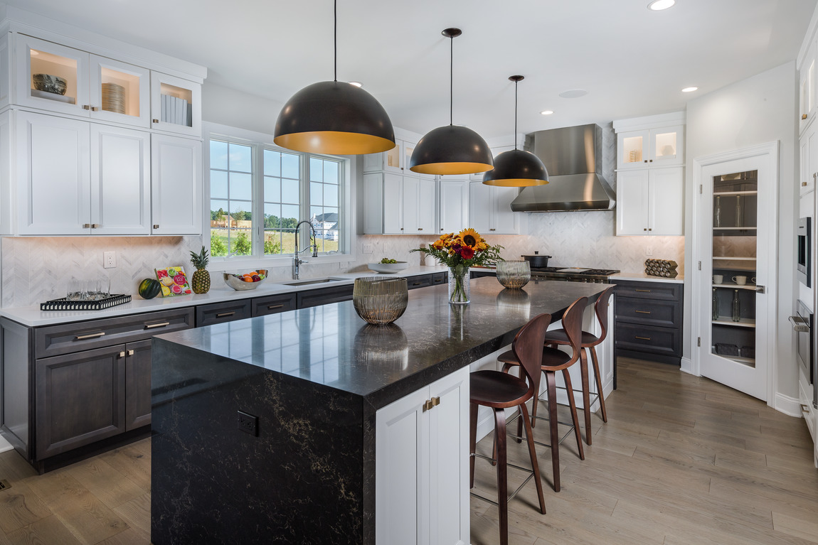 Spacious kitchen with spectacular pendant lighting