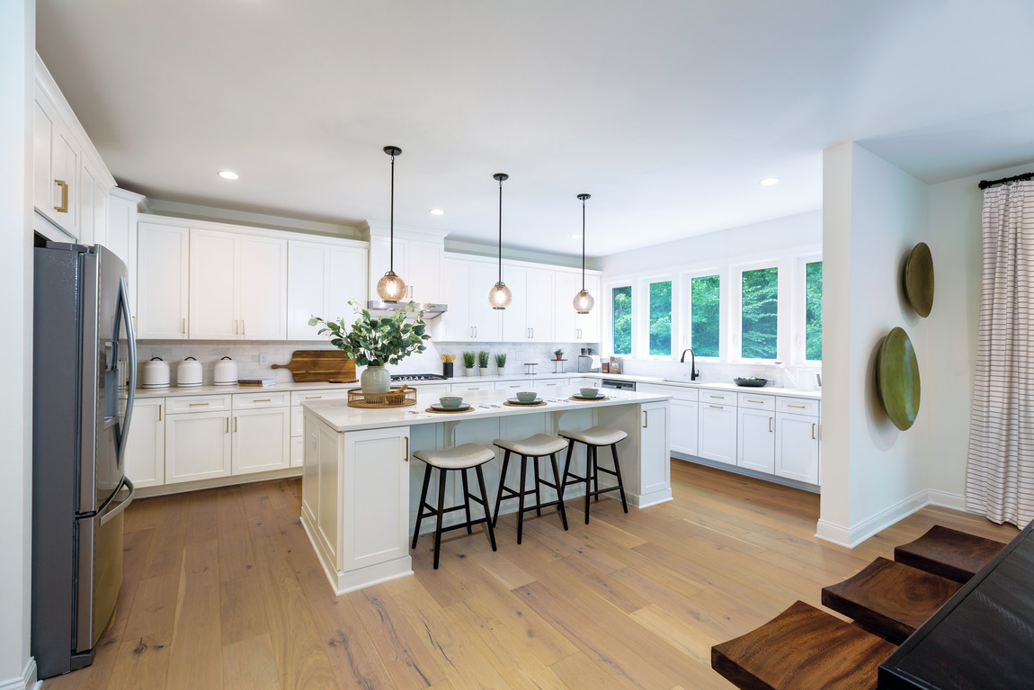 Large modern kitchen with copious natural lighting and lighting fixtures