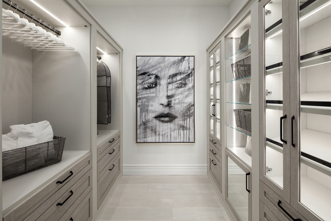Grey neutral closet with white paint and artwork.