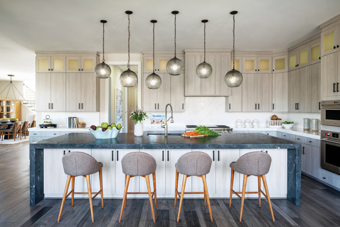 Luxury kitchen featuring island with ample storage space
