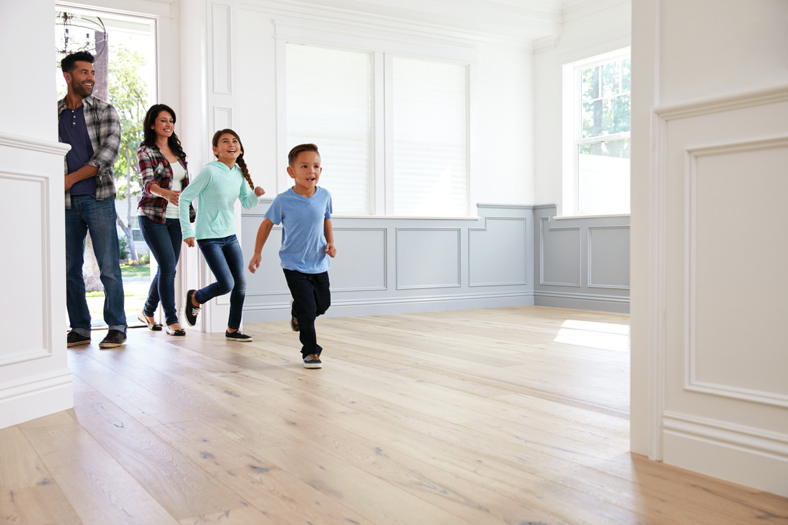 Family moving into their new home after finished with packing