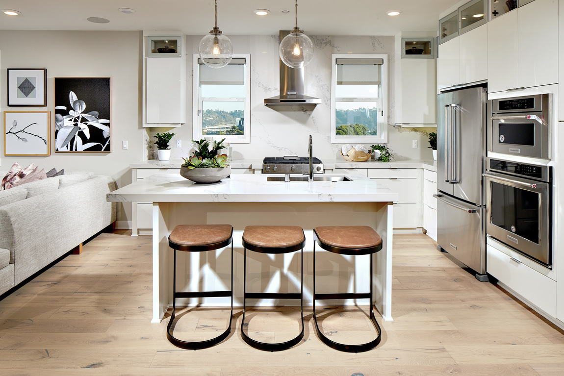 Luxury kitchen with leather island seating.