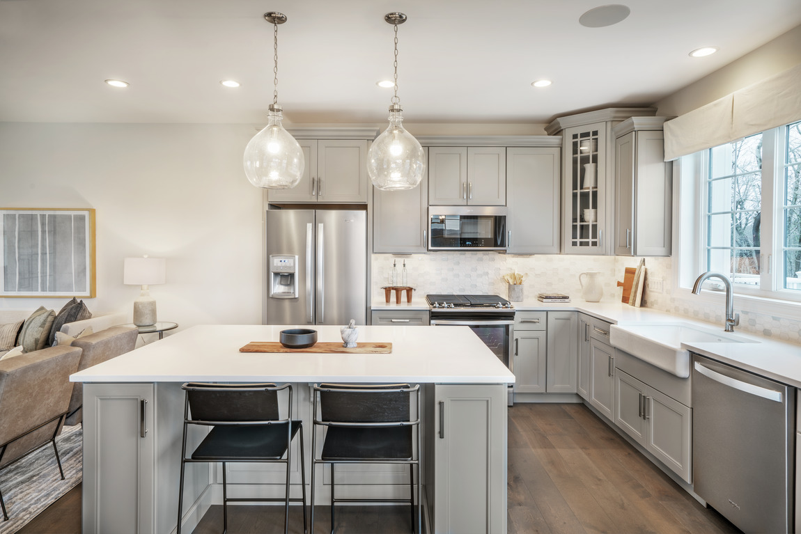 Simple kitchen with sleek island and seating