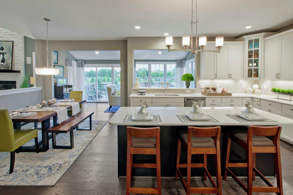 Transitional kitchen with classic wooden stools