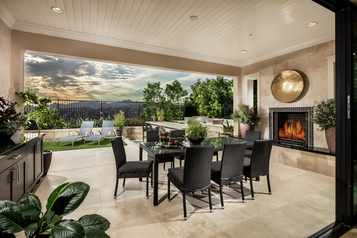 patio with fireplace and table