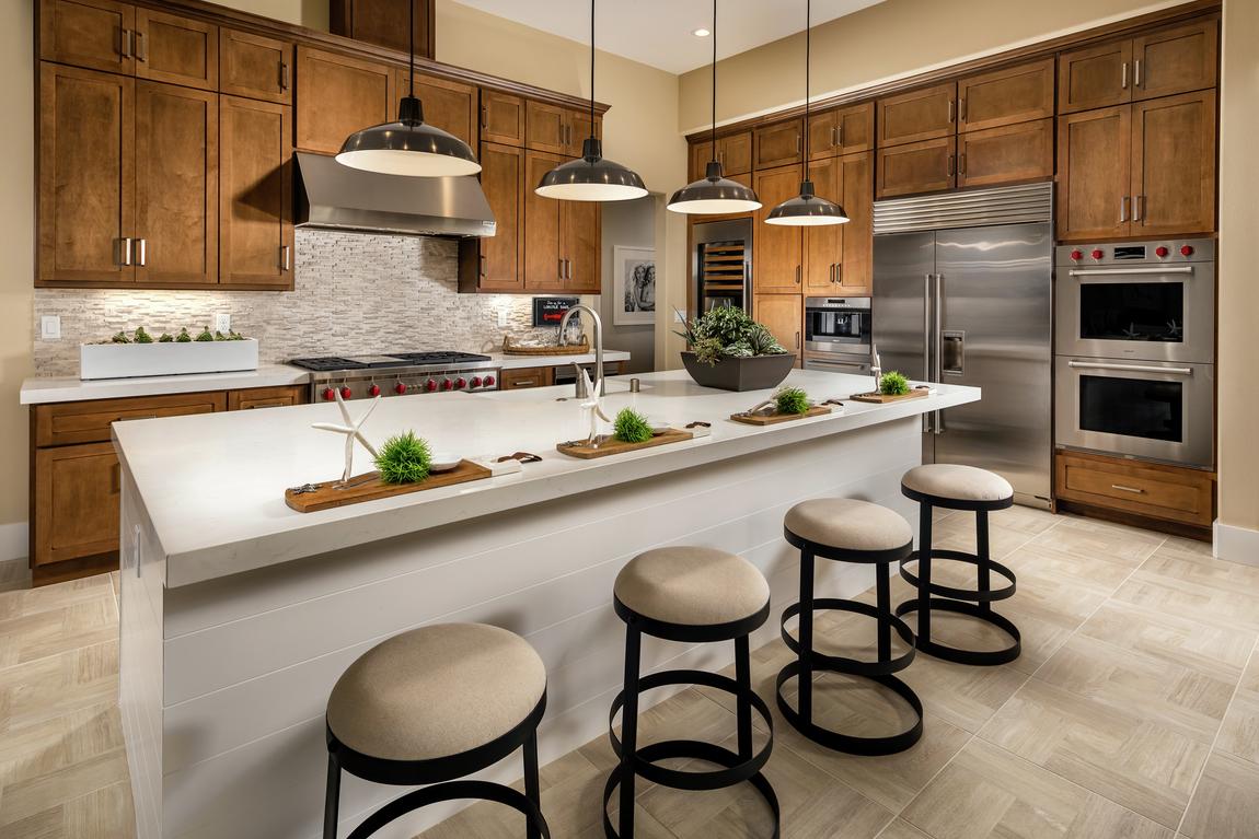 Warm, inviting modern farmhouse kitchen with circular bar stools.
