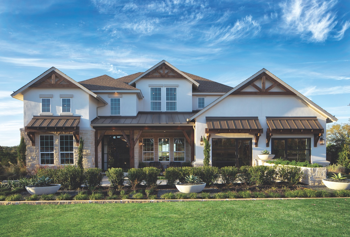 A stone and stucco home with painted metal roofs.
