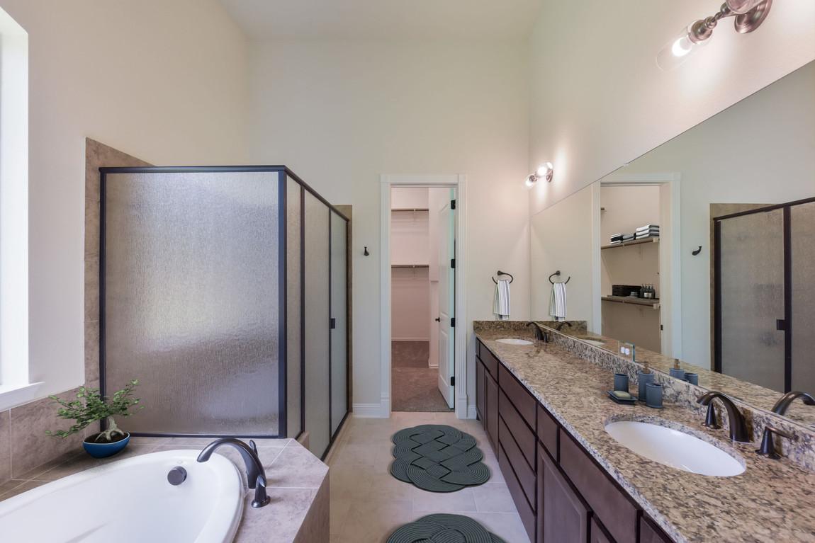 Kitchen with granite vanity countertop