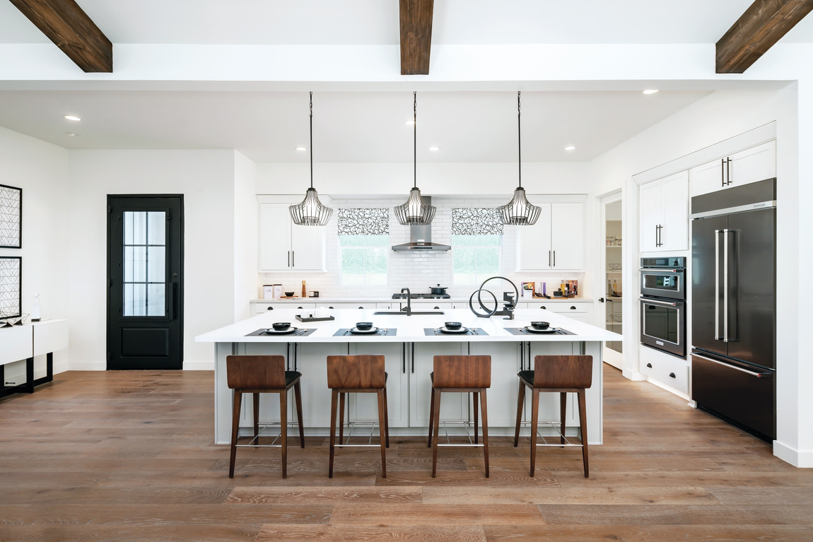 Modern farmhouse kitchen design with a large island.