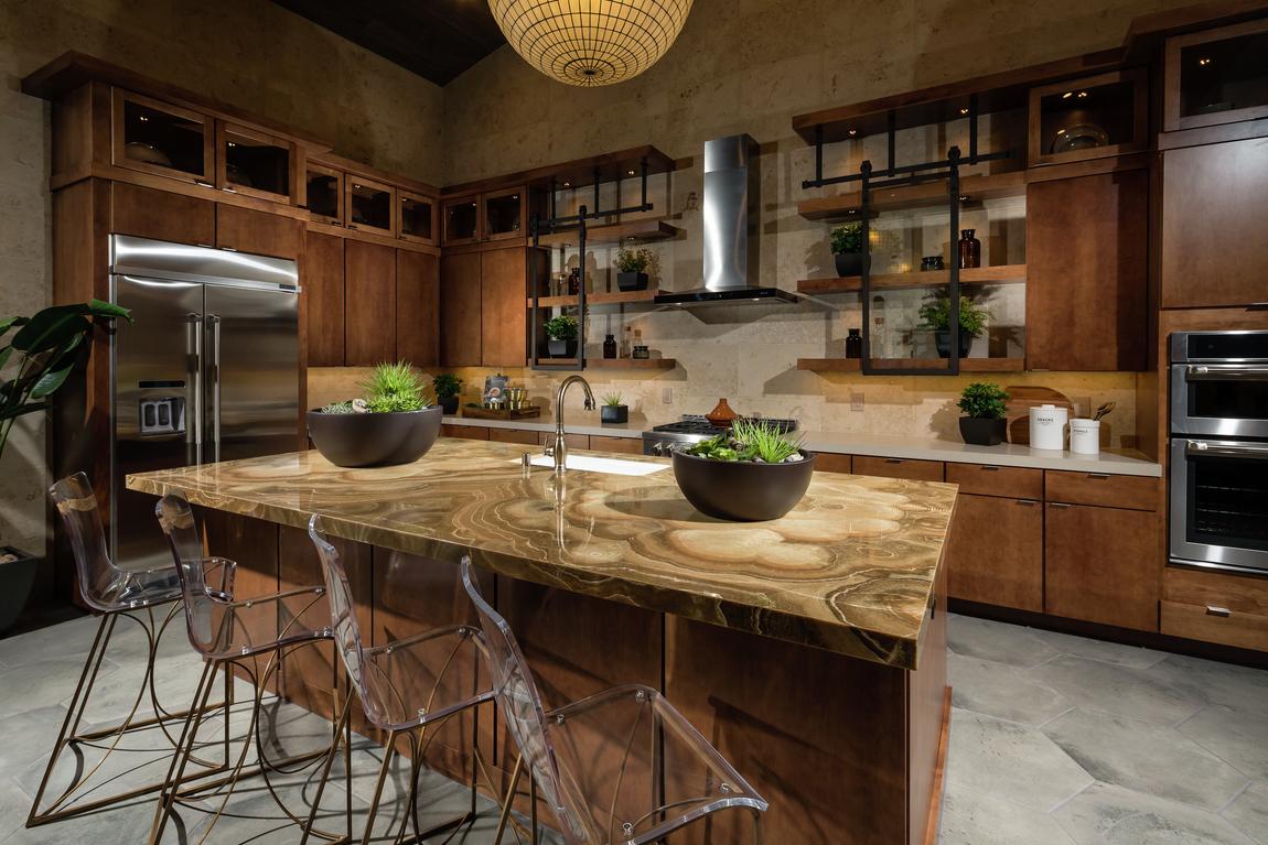 Beautiful waterfall island in dark toned kitchen