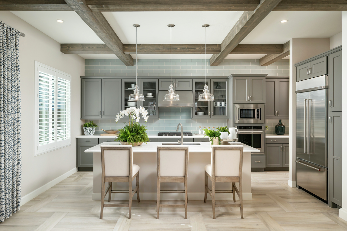 Luxury kitchen highlighted by a beam ceiling.