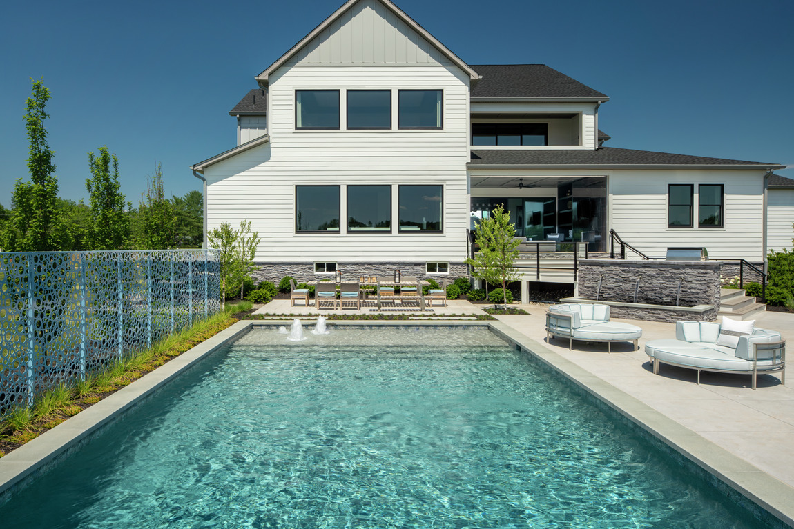 Backyard highlighted by luxe pool
