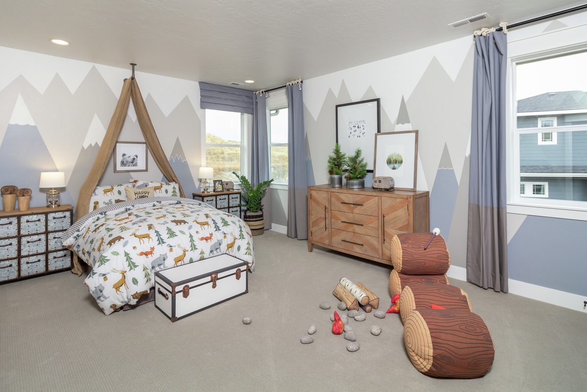kids bedroom featuring dressers and storage chest