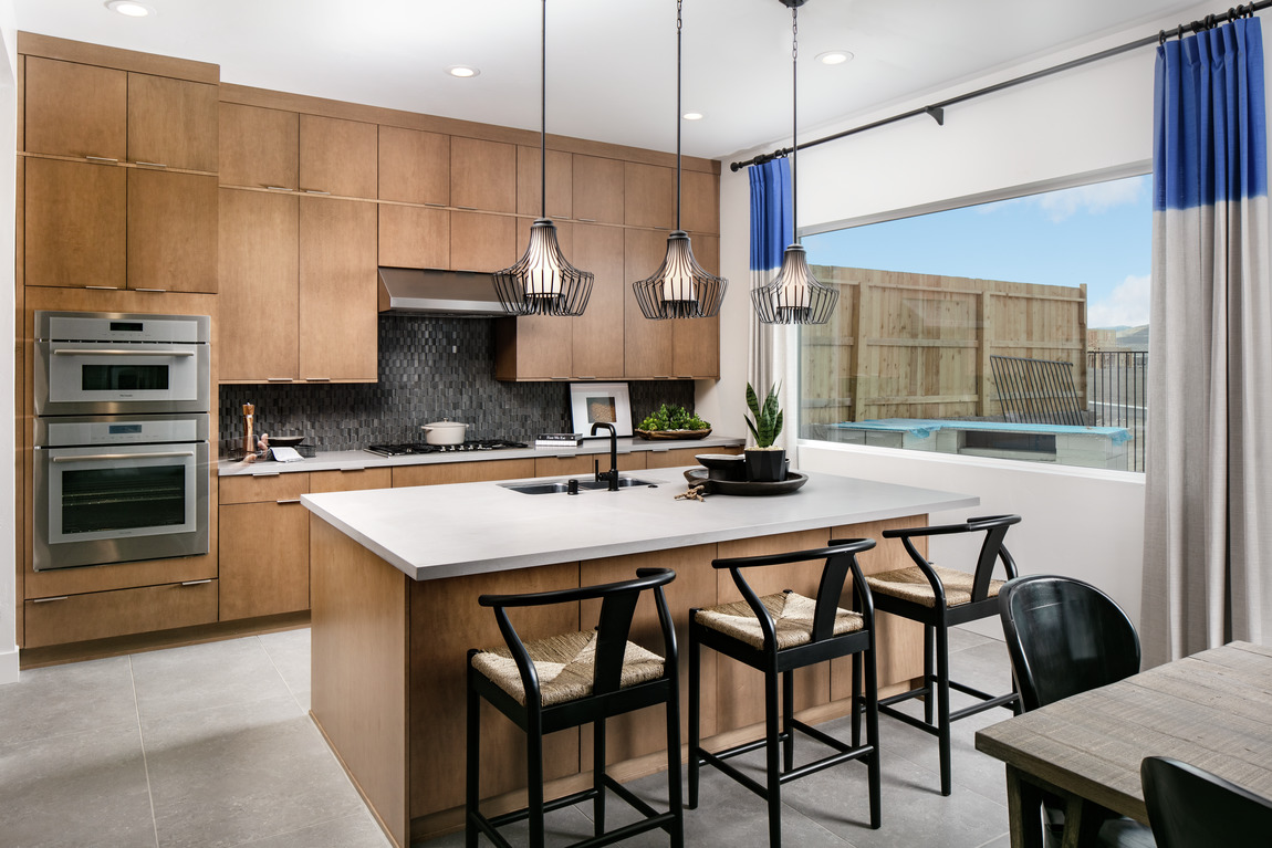 Modern kitchen with natural lighting and a nordic design aesthetic.