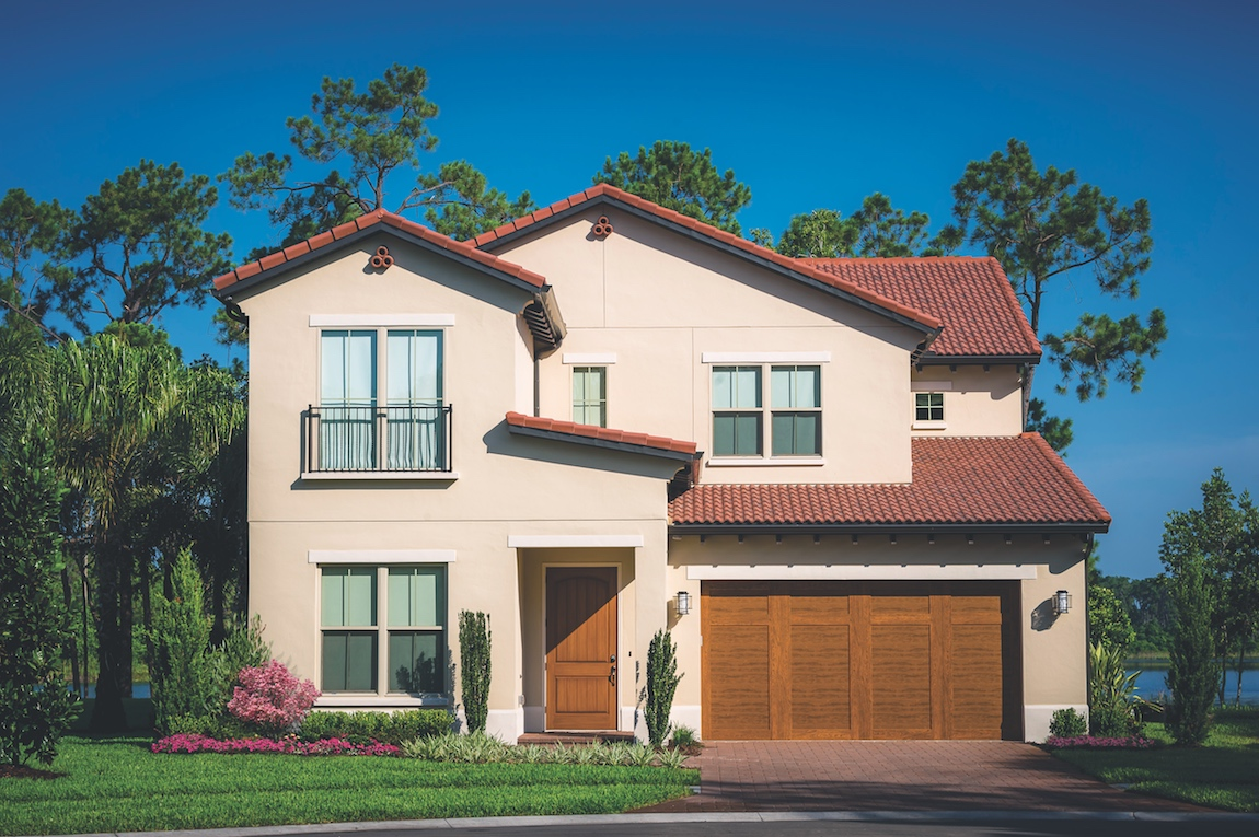 A Toll Brothers mediterranean home design with terracotta roof tiles.