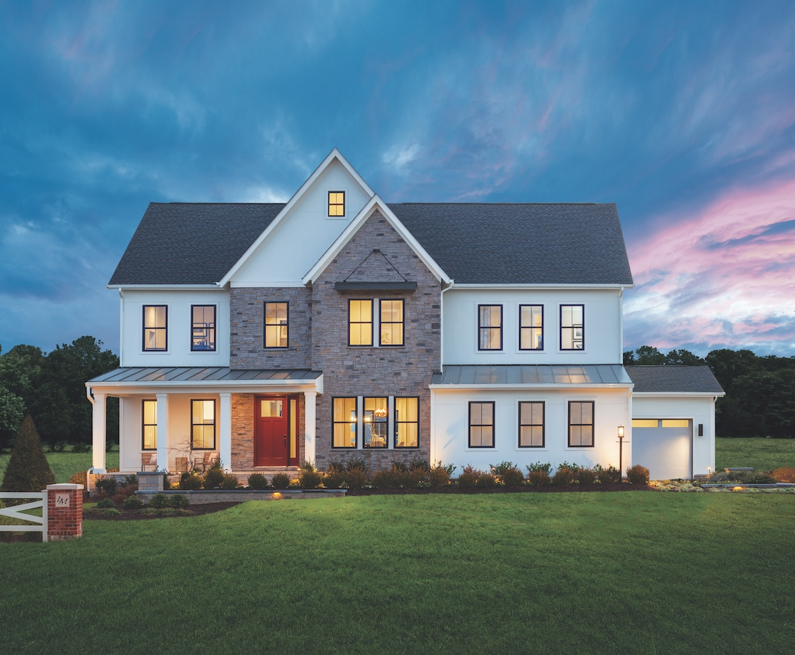 Exterior of a new construction home in Virginia with subtle outdoor lighting.