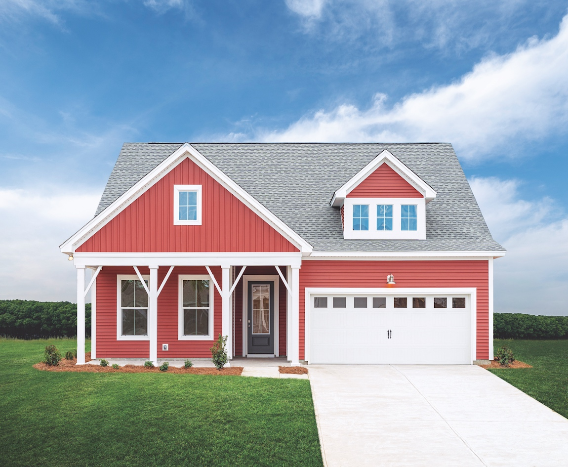 A craftsman design with a white and red exterior home color combination.