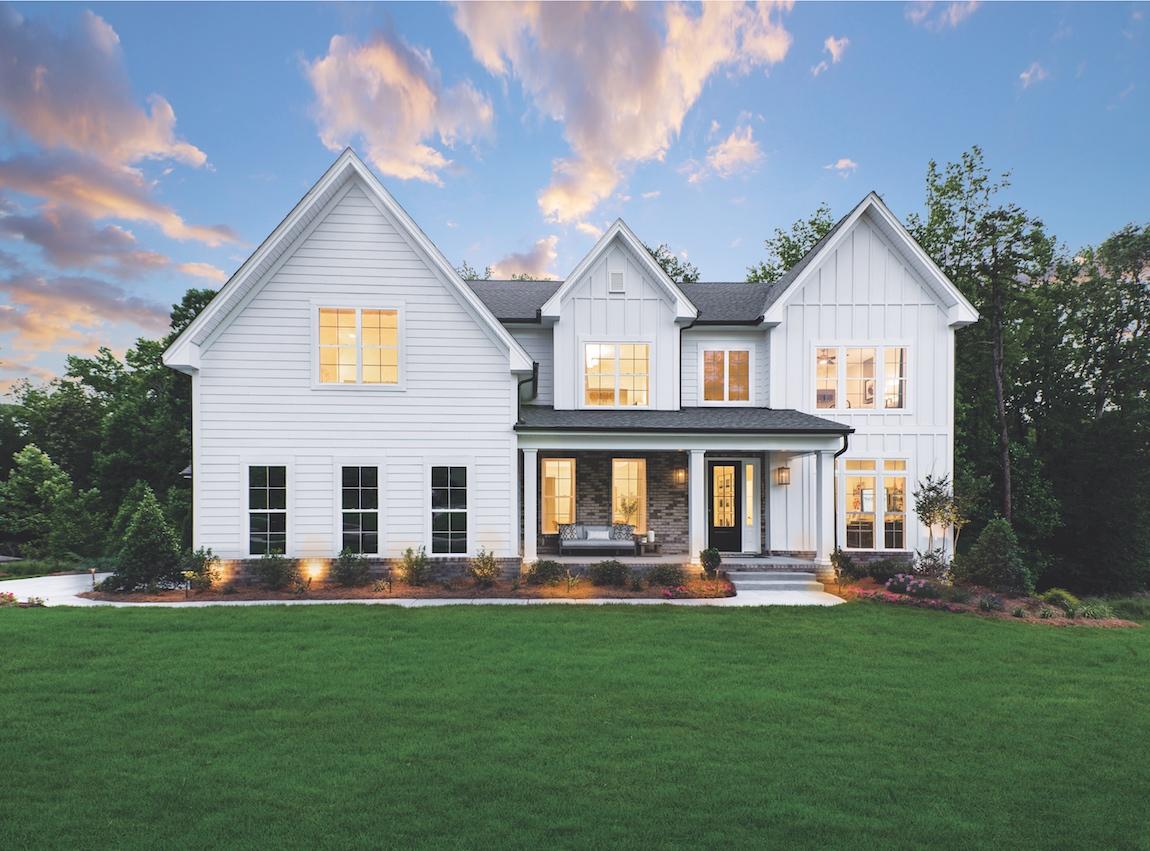 An all-white modern farmhouse exterior.