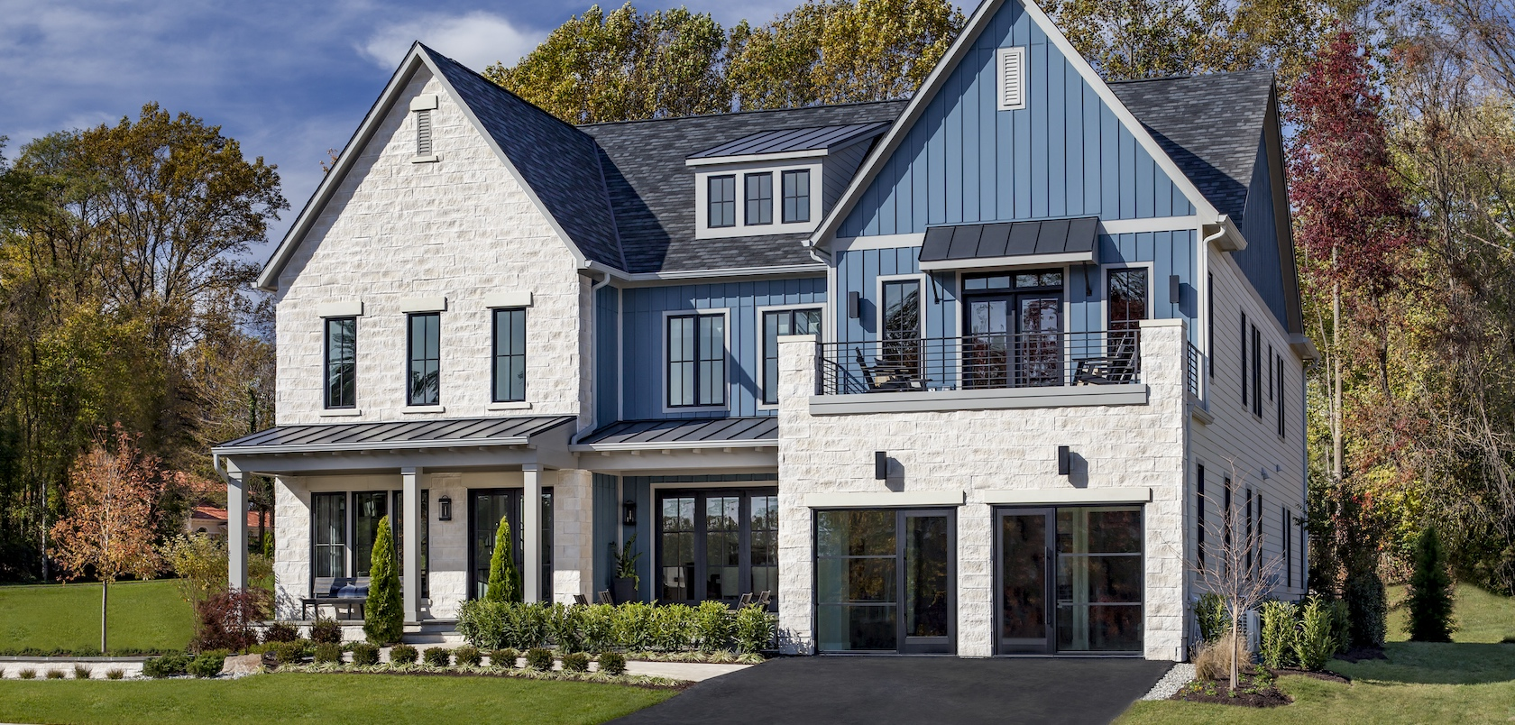 A modern farmhouse Toll Brother home with a light blue exterior color.