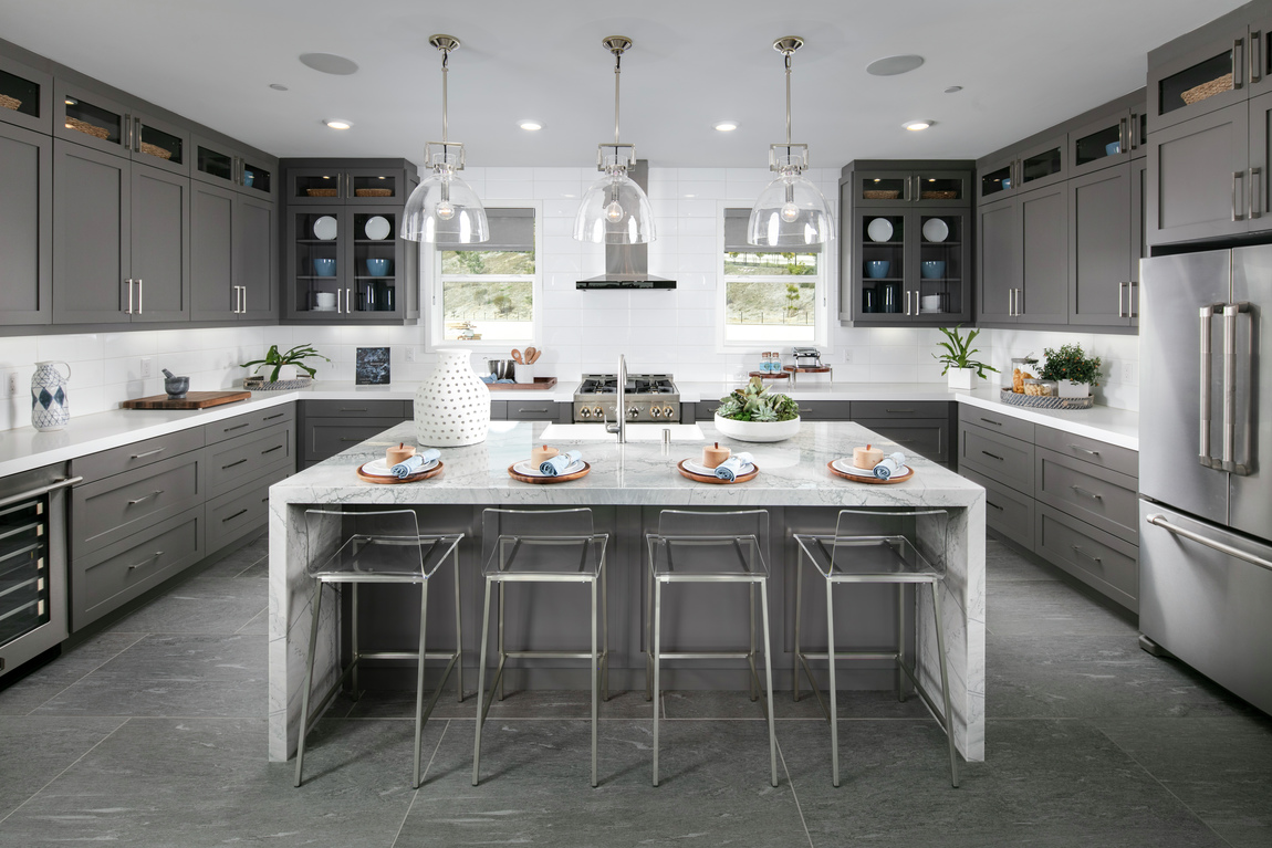 A luxury kitchen with seating for four at the large kitchen island.