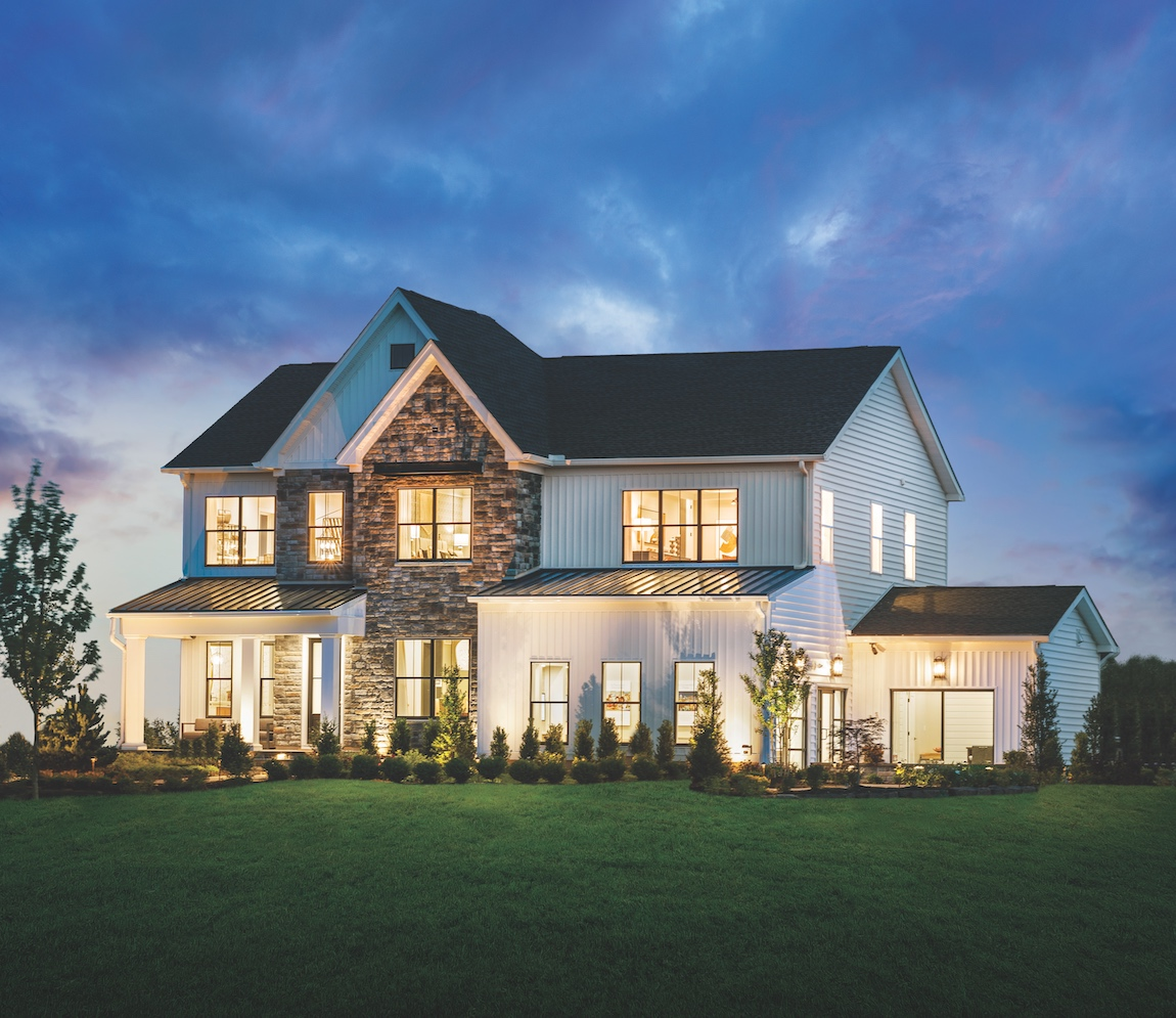 Luxury home in Pennsylvania with accent lighting along the exterior.