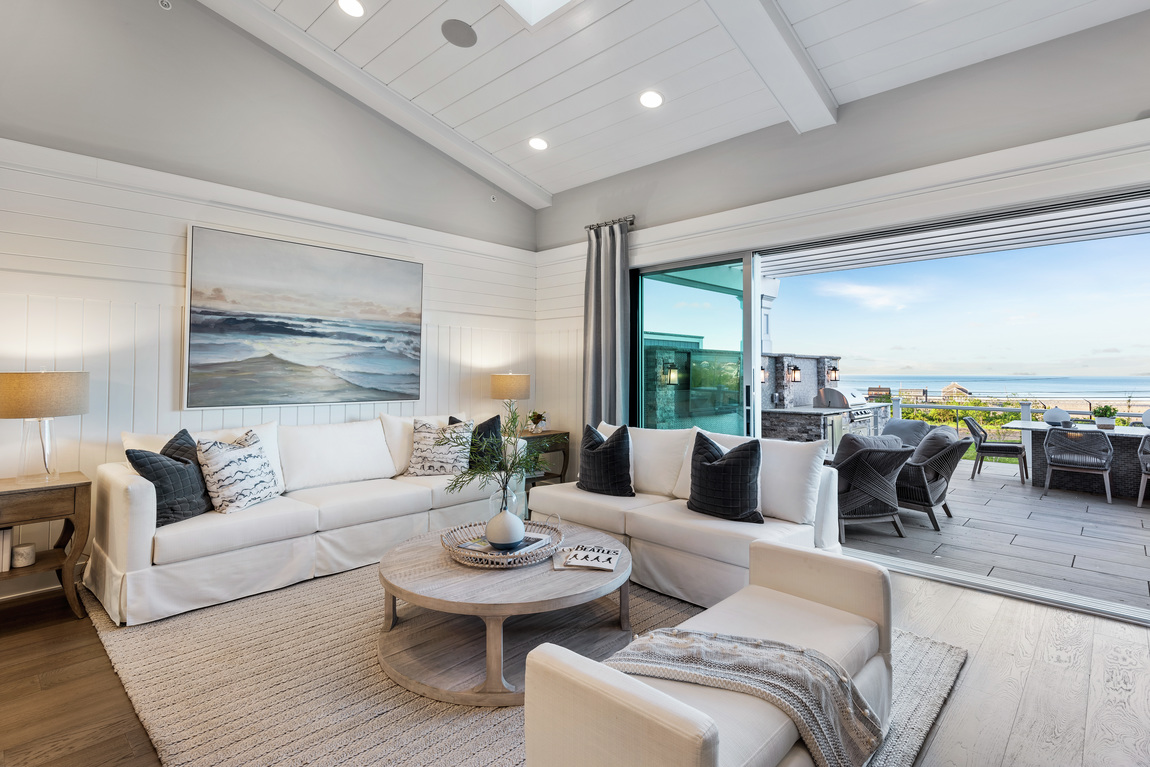 Living room with coastal artwork that plays into home's overall ambiance