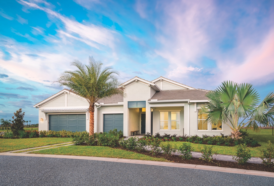 Exterior of a Toll Brothers home with gray aqua doors.