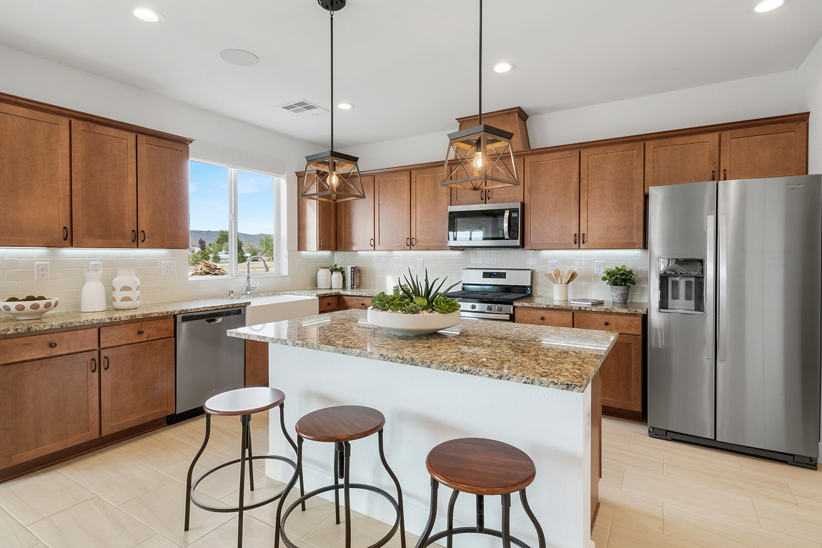 Luxe kitchen with elegant pendant lighting and granite countertop island