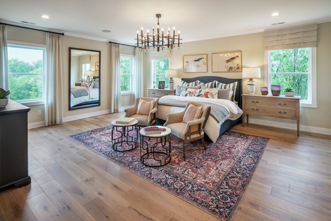 A classically designed bedroom with an elegant rug.