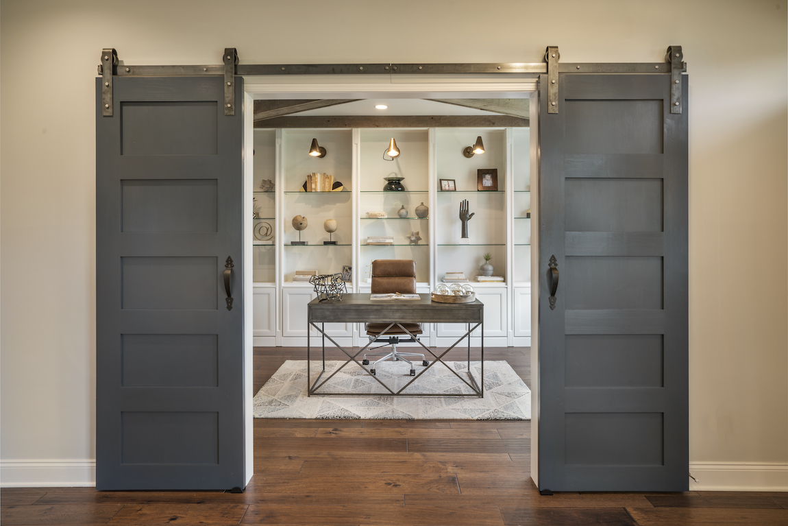 Craftsman style barn door in a home office.