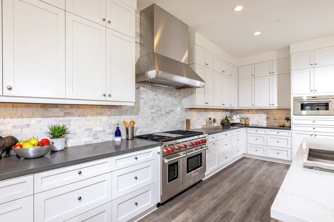 kitchen with gray modern backsplash