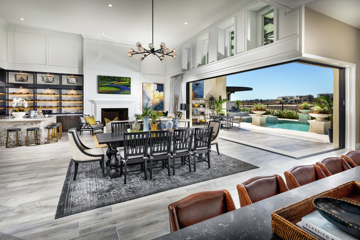 Open concept floor plan leading to an outdoor space in a luxury home.